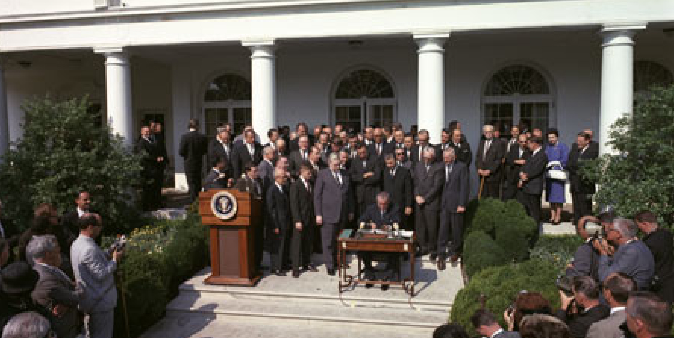 Signing the Economic Opportunity Act of 1964 to fight America�s War on Poverty